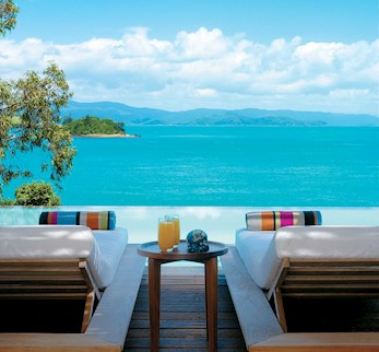 Relax on your day bed with a view of the Whitsundays - romantic packages Hamilton Island